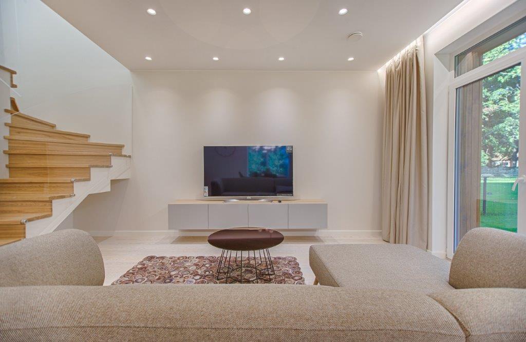 Innenausbau Treppe Stiegenbau Steiermark Geländer Architektur Beleuchtung Boden Couch